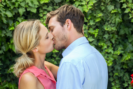 front yard: Happy romantic couple kissing at front yard Stock Photo