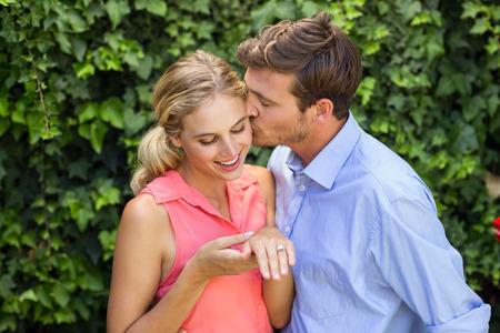 front yard: Happy romantic man kissing woman at front yard