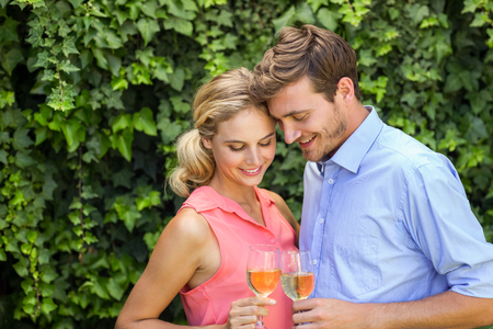 front yard: Romantic happy couple toasting wineglasses at front yard