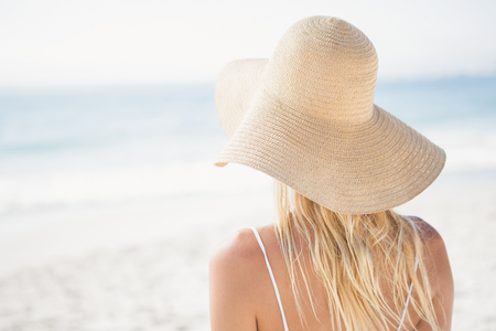maxi dress: Blonde woman posing on the beach on a sunny day Stock Photo