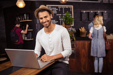 service desk: Man using a laptop in a coffee shop Stock Photo