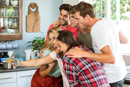 middleaged: Group of friends taking a selfie at home Stock Photo