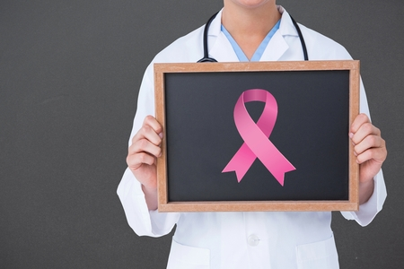 aids symbol: Composite image of doctor holding board with aids symbol on black background