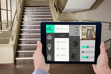 Digital composite of Man using tablet for home automation