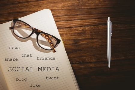 mindmap: Notebook with social media terms lying on table