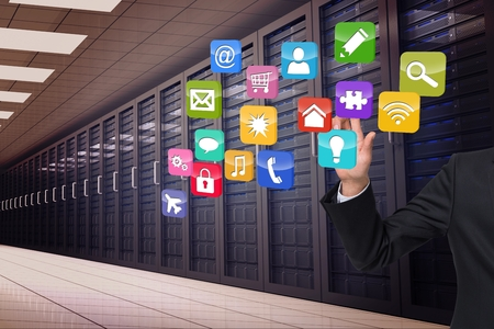 composite image: Composite image of businessman touching apps in server room