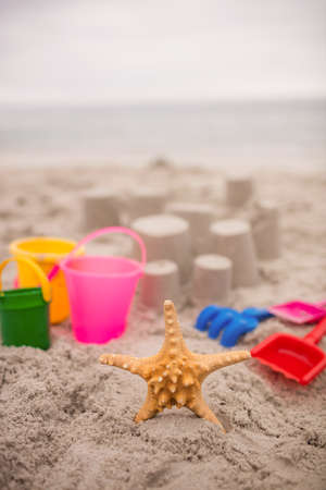 bucket and spade: Sandcastle with bucket and spade at beach on a sunny day LANG_EVOIMAGES