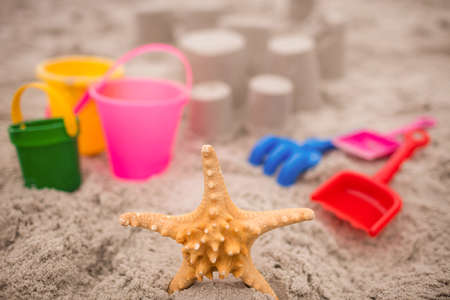 sandcastle: Sandcastle with bucket and spade at beach on a sunny day LANG_EVOIMAGES
