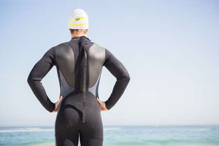 swimming cap: Handsome man wearing swimming cap on the beach