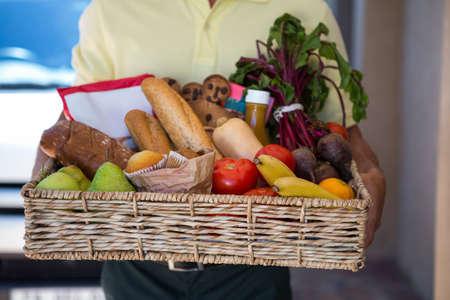 delivering: Man delivering online grocery order LANG_EVOIMAGES