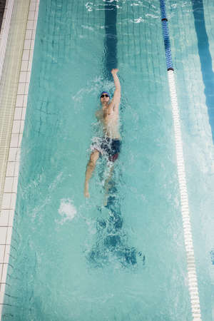 backstroke: Swimmer doing a backstroke in the pool at leisure center