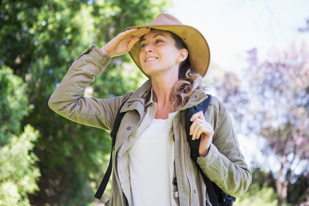 observing: Woman observing something in the countryside Stock Photo