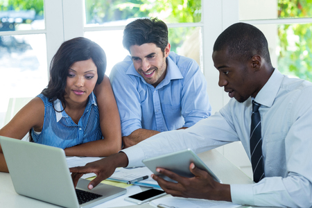 Couple and real estate agent discussing together at home Stock Photo