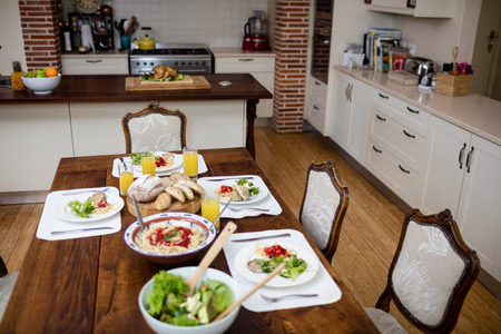dinning table: Dinning table laid with meal in kitchen