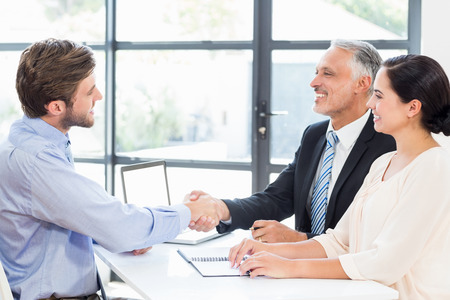 businessmen shaking hands: Businessmen shaking hands at a meeting in office
