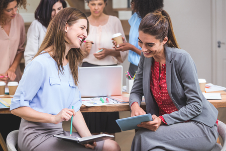 interior designer: Group of interior designer interacting with each other in office