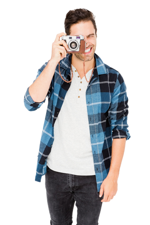 Man photographing with camera on white background Stock Photo