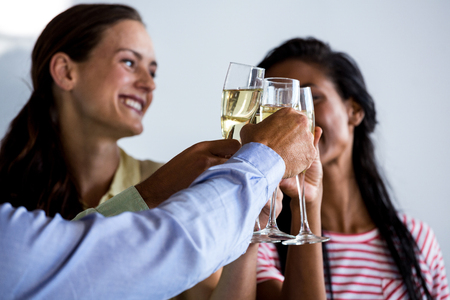professional flute: Colleagues toasting champagne flutes in office