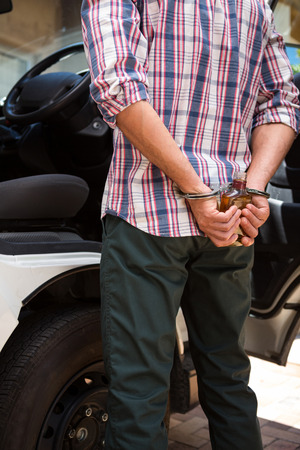 drinking driving: Man handcuffed behind his back for drinking and driving Stock Photo