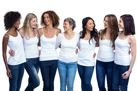 together standing: Happy multiethnic women standing together on white background Stock Photo