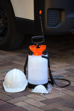 sprayer: Insecticide sprayer on pavement