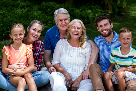 hapy: Potrait of hapy family relaxing on grass at yard Stock Photo