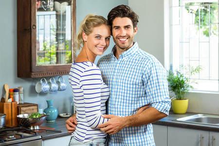 each other: Portrait of romantic couple embracing each other in kitchen Stock Photo