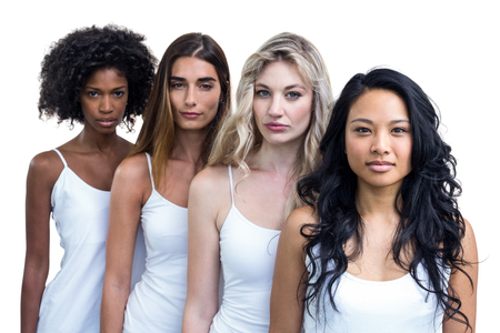 Multiethnic women standing in a line on white background
