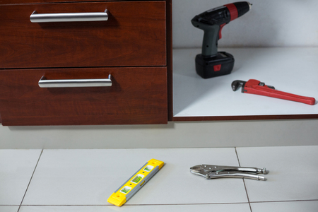 work from home: Various work tools near drawer at home Stock Photo