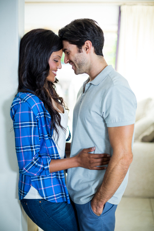 each: Young couple embracing each other at home Stock Photo