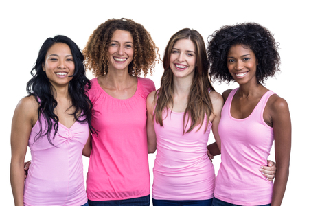 Portrait of smiling women in pink outfits standing on white background