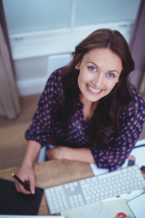 input device: Portrait of beautiful woman smiling at home Stock Photo