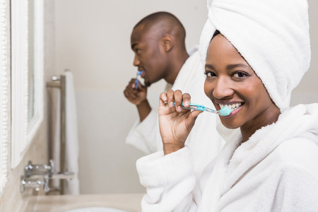 Young couple brushing teeth in the bathroom Stock Photo