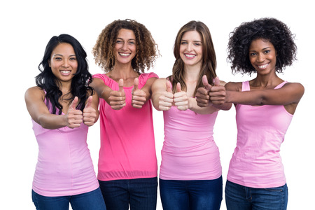 Portrait of women in pink outfits showing their thumbs up on white background
