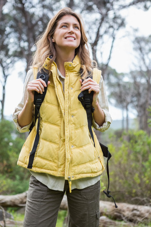 adventuring: Smiling woman with backpack in the countryside