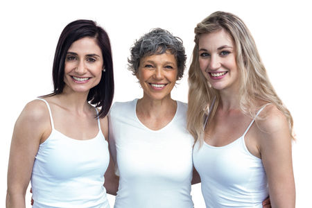 together standing: Portrait of women standing together with arm around on white background