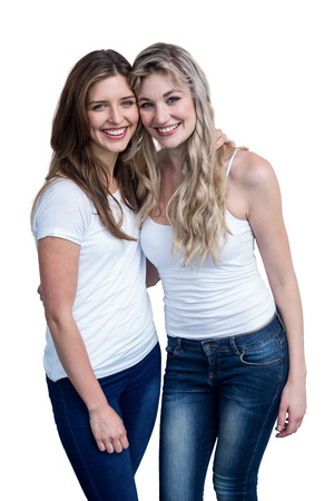 arms around: Happy female friends standing together with arms around on white background Stock Photo