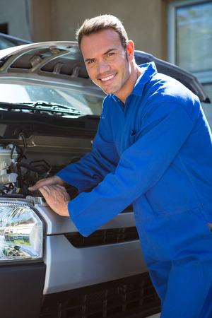shop skill: Portrait of mechanic examining the car at the repair garage