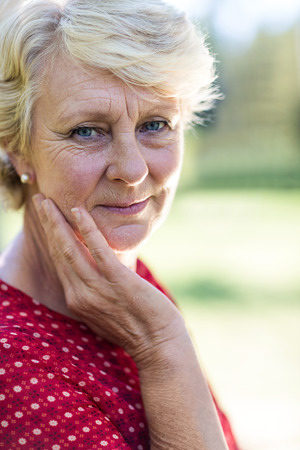 the ageing process: Close-up of a senior woman in park