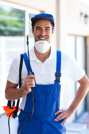 crop sprayer: Portrait of confident pesticide worker standing in back yard