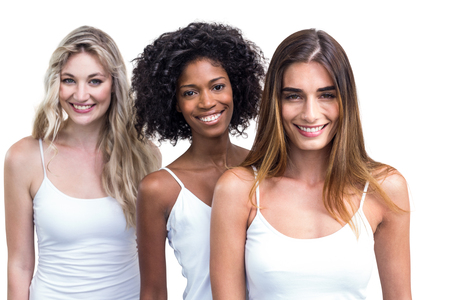 standing in line: Multiethnic women standing in a line on white background
