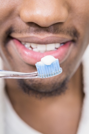 domiciles: Close-up of a man holding tooth brush