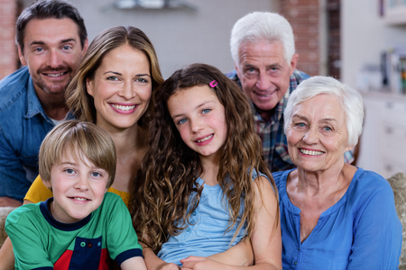 multigeneration: Portrait of smiling multi-generation family at home Stock Photo