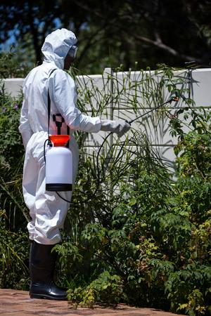 crop sprayer: Man doing pest control in the backyard Stock Photo