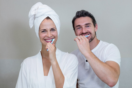 couple bathroom: Couple brushing their teeth in the bathroom at home Stock Photo