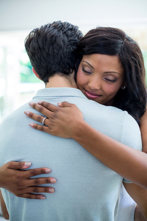 each other: Young couple embracing each other at home Stock Photo