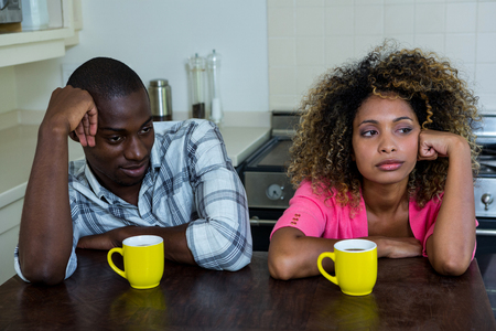 ignoring: Upset couple ignoring each other after fight at home