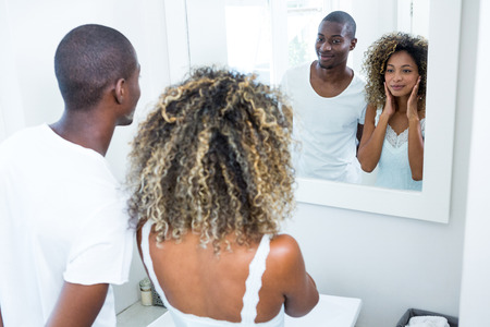 couple bathroom: Young couple standing in bathroom at home Stock Photo