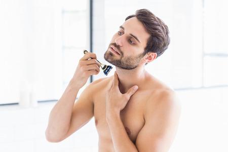 masculinity: Man shaving in the bathroom