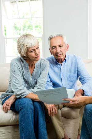 image consultant: Cropped image of consultant showing report to senior couple at home